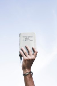 Hand held bible - ian-espinosa-243798-unsplash